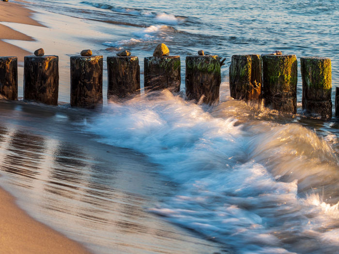 High angle view of wooden posts on sea