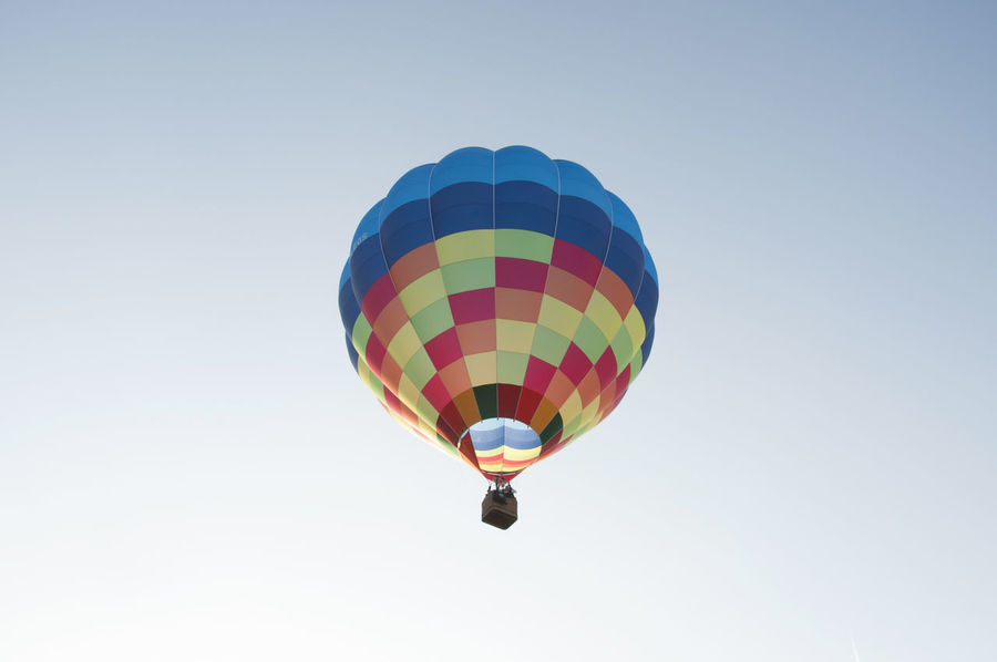 Hot air balloon Adventure Ballooning Ballooning Festival Centered Composition Clear Sky Day Extreme Sports Flying Hot Air Balloon Low Angle View Mid-air Multi Colored Multicolor Outdoors People Sky Squares