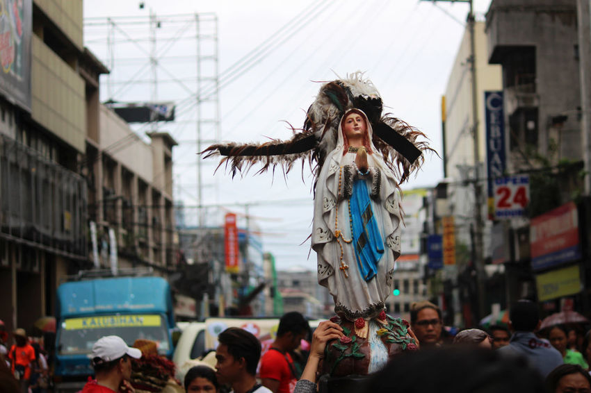 A statue of Mother Mary in colon street as procession is still going on. Sinulog Festival Traditional Festival Traditional Culture Carnival - Celebration Event Celebration Adult Day Outdoors People Only Women Adults Only Sky
