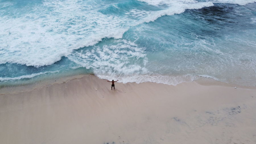 High angle view of man standing on beach
