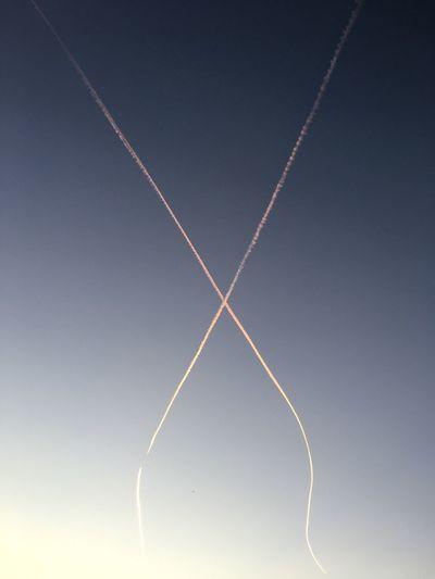 Vapor trails against sky