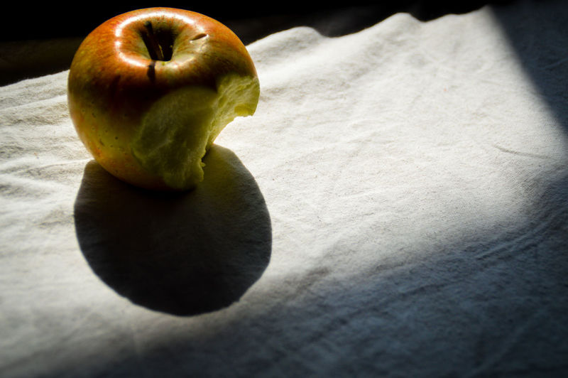 Tell me no secret and I'll tell you no lies.Bitten Apple Fruit Food Green Color Healthy Eating Food And Drink Shadow Freshness Granny Smith Apple No People Indoors  Day Half Eaten Apple Shadow And Light Sunlight And Shadow Conceptual Still Life Shadows And Sunlight Conceptual Photography