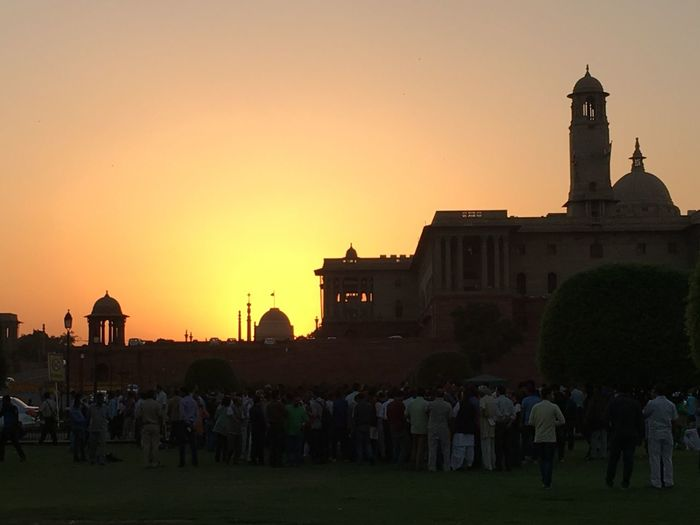 the sun sets and a golden evening at the majestic Vijay Chowk with the dome of India`s Presidential Palace ( Rashtrapati Bhawan ) in the background Architecture Built Structure City Dome Of Rashtrapati Bhawan In The Background End Of Day Evening Comes Golden Sky Imperial Colonial Architecture North Block Silhoette Sky Sunset Travel Destinations Vijay Chowk