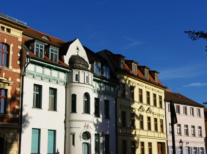 Low Angle View Of Buildings Against Clear Sky