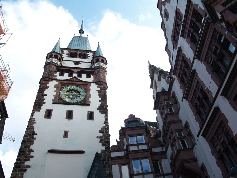 Photos of Freiburg, Germany 2007 Architecture Blue Sky And Clouds Clock Clock Tower Old Buildings Tower White Clouds White Clouds And Blue Sky