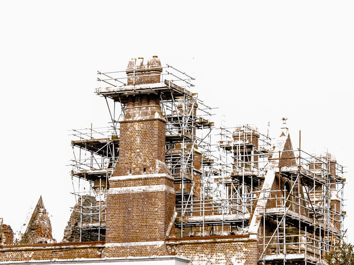 scaffolding Architecture Building Exterior Built Structure Clear Sky Construction Industry Construction Site Copy Space Day Development Factory Industry Low Angle View Metal Nature No People Outdoors Sky Tall - High Travel Destinations
