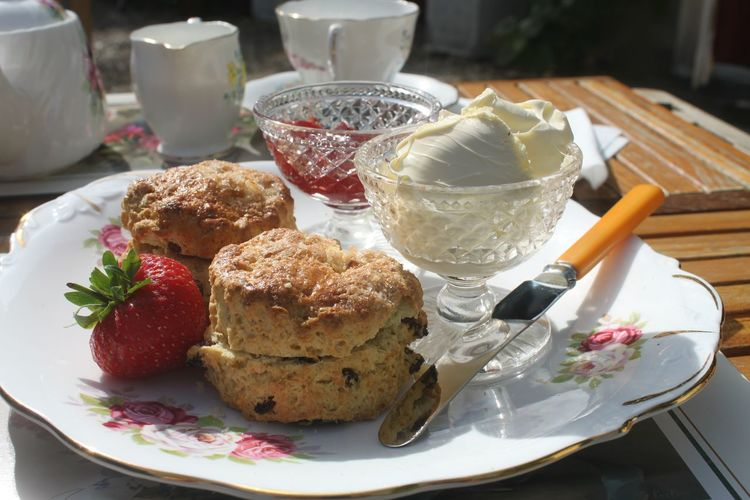 Close-Up Of Scones By Ice Cream In Plate On Table