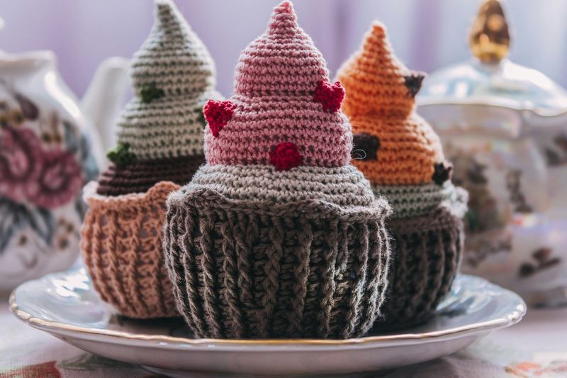 Close-up of crochet cupcakes in plate