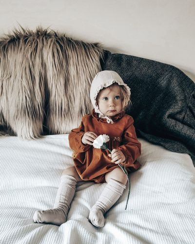 Portrait of cute nordic fashion toddler girl sitting