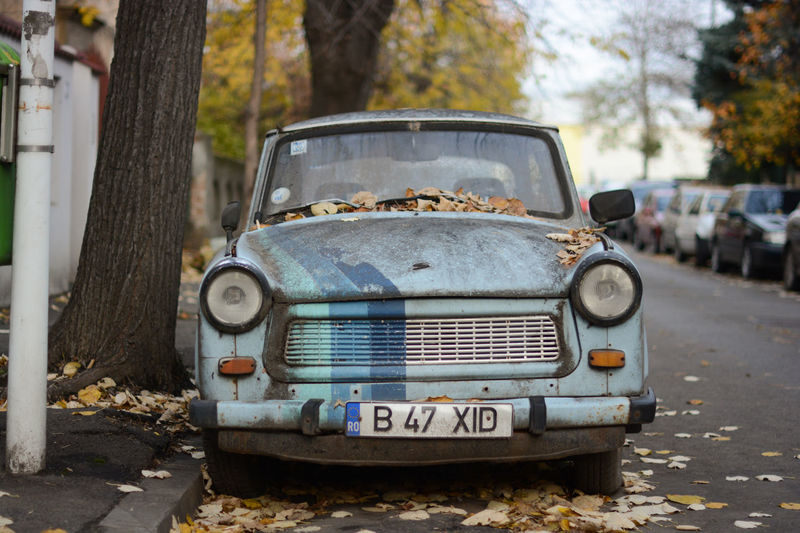 Trabant Sport. Several Trabant remain in Bucharest, some with quite creative decorations. I found this lonely one during a walk last autumn. Autumn Leaves Car Portrait The Week On EyeEm Trabant Travel Photography Traveling Car Close-up No People Outdoors Sky Blue Street Photography Transportation Vintage Cars Colour Your Horizn Stories From The City