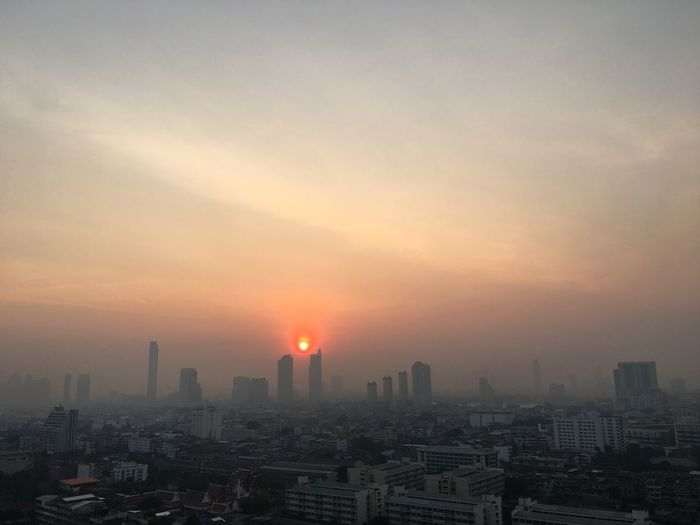 Dusty sky Bangkok Thailand #Thailand #Bangkok #EyeEmSelects #cloud #dusty #Sunrise #smoke Building Exterior City Architecture Cityscape Built Structure Sky Building Skyscraper Urban Skyline Nature City Life No People Sun Cloud - Sky Residential District
