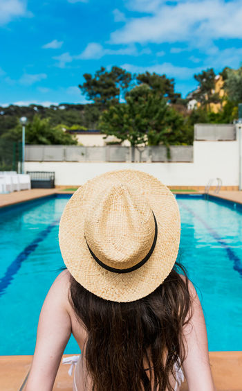 Hat Swimming Pool Pool Rear View One Person Women Real People Water Clothing Leisure Activity Lifestyles Poolside Nature Day Sun Hat Outdoors Hairstyle