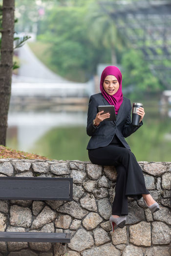 Young businesswoman wearing hijab using digital tablet
