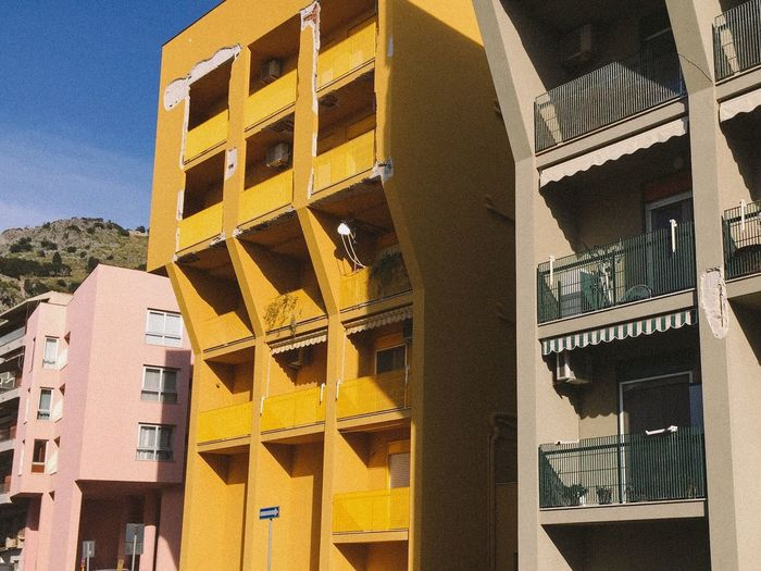 The Architect - 2017 EyeEm Awards Architecture Built Structure Building Low Angle View Yellow Outdoors Day No People City Cefalu  Sicily Sicilia Yellow Color Architectural Empty Warm Colors Architecture Colors Geometric Shape
