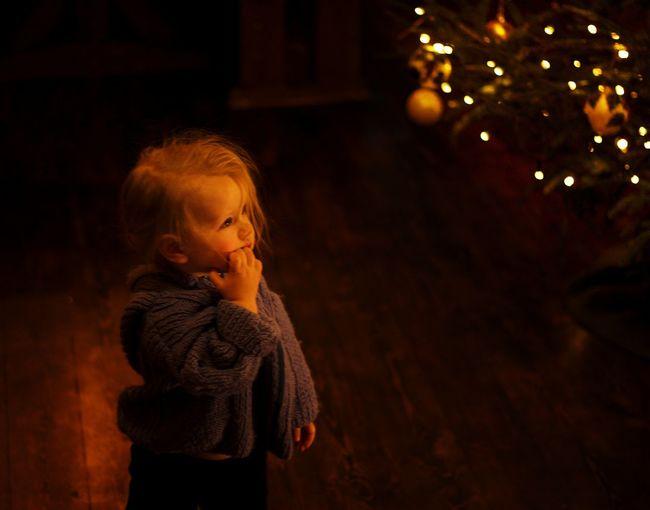 Girl looking at illuminated christmas lights