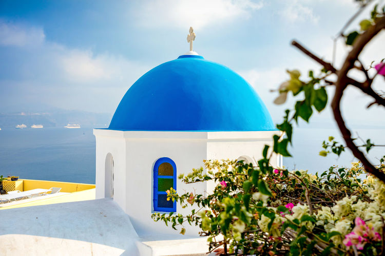 Greece Santorini Oia Thira Religion Belief Spirituality Dome Sky Built Structure Architecture Place Of Worship Nature Blue Building Exterior Cloud - Sky Water Building No People Plant Day Outdoors Horizon Over Water