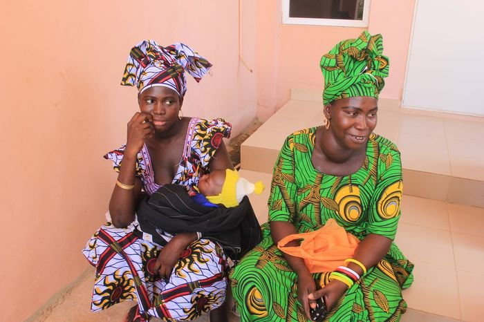 African women in maternity clinic Gambia Goiter African Fashion Vlisco Gambia  Mother And Baby African Mother African Women Mothers Young Women Looking At Camera