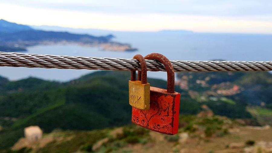 Love Sign Seascape Coastline Tranquil Scene Tirrenic Sea Coast Panoramic View Love Lock Water Hanging Luck Lock Padlock Safety Security Symbolism Chain Representing Iron Rocky Coastline #NotYourCliche Love Letter