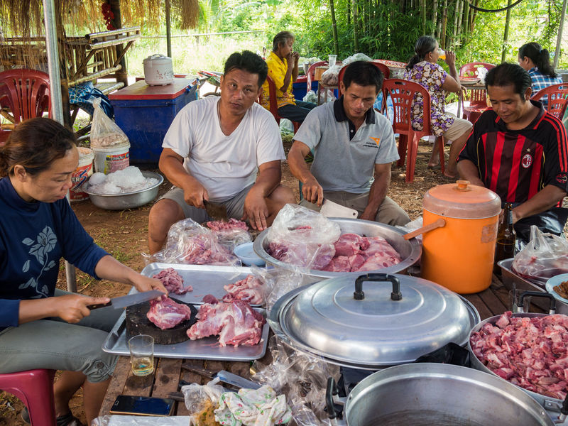Group of people are preparing the food for the wedding party in Thailand Connected By Travel Cooking EyeEmNewHere Looking At Camera Man Sitting Outside Thailand Wedding Preparation Cutting Meat Day Food Food And Drink Freshness Group Of People Meat Men Outdoors People People Cooking Preparing Food Real People