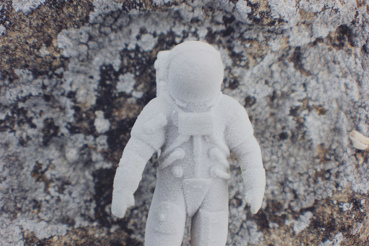 Close-up of toy against rock