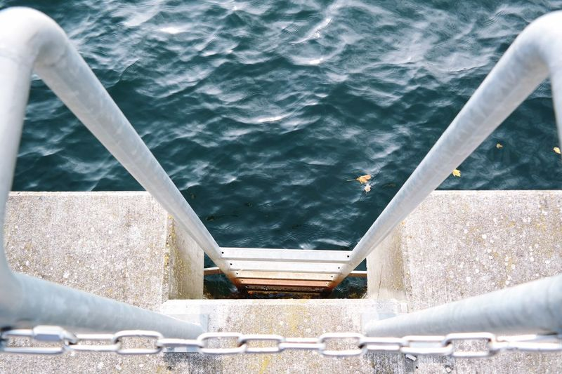 go below Water Nautical Vessel Boat Ladder Ladder To Nowhere Sea Rippled Mode Of Transport Cropped Railing Outdoors Jetty Day Blue Calm Ocean Sailing No People Water Surface Diminishing Perspective Dock Minimalist Architecture