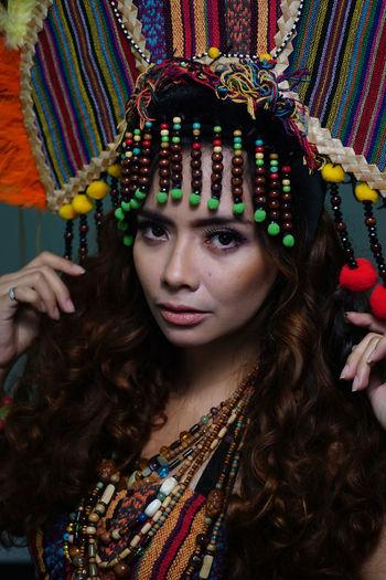 Portrait of beautiful young woman wearing headdress