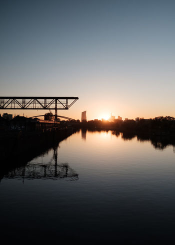 Sky Water Reflection Architecture Sunset Built Structure Nature Beauty In Nature Waterfront No People Lake Sun Scenics - Nature Building Exterior Tranquility Silhouette Tranquil Scene Outdoors Copy Space