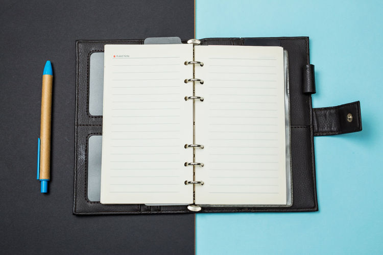 Book Publication Note Pad Page No People Pen Paper Indoors  Open Diary Blue Close-up Still Life Education Writing Instrument Directly Above High Angle View Pencil Blank