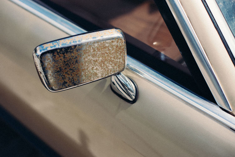 High angle view of rusty side-view mirror