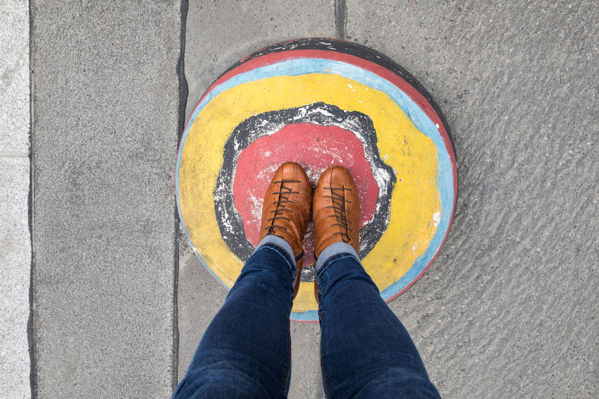 Standing on a colorful hemisphere Adult Asphalt Casual Clothing Concrete Directly Above Hemisphere High Angle View Human Body Part Human Foot Human Leg Lifestyles Low Section Multi Colored One Person One Woman Only Paint Personal Perspective Real People Road Shoe Sphere Standing Street Textured  Vibrant Color Paint The Town Yellow