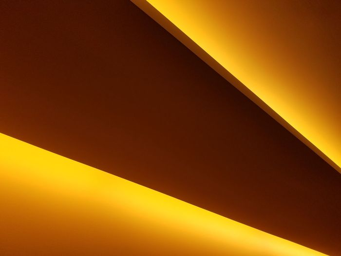 Yellow Architecture Built Structure Wall - Building Feature Close-up Wall Full Frame Orange Color Ceiling Geometric Shape Vibrant Color Brown Enjoying Life Taking Photos Architectural Design Illuminated High Section Detail ArchitectureArchitectural Feature Yellow Color No People Modern Angle LINE