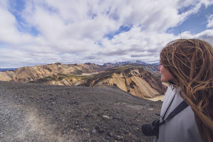Portrait of woman against mountain range against sky