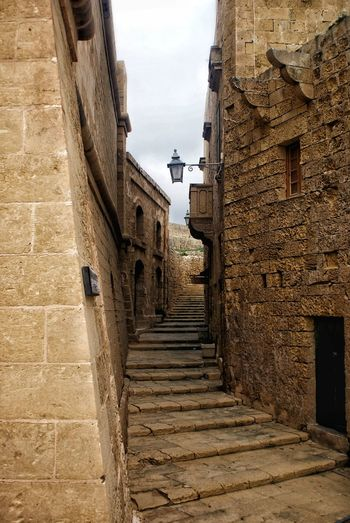 Malta History Historic Medieval Street Alley Mediterranean  Brick Yellow Brick Travel Destinations No People Old Buildings Architecture Built Structure Medieval Citadel Maltese