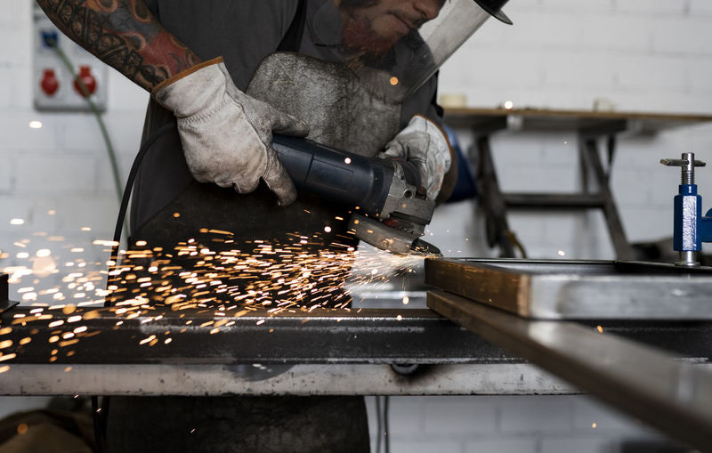 Man working on barbecue grill