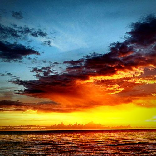 Sunset Sea Dramatic Sky Horizon Over Water Seascape Beach Scenics Water Landscape Nature Cloud - Sky Vacations Tranquility Sky Beauty In Nature Travel Destinations Outdoors Reflection Blue Tranquil Scene Waterfront Nature No People Beauty In Nature Day