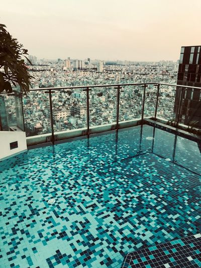 A pool with a view Cityscape Panorama View From The Pool Amazing View Swimming Pool Pool Vietnam ShotOnIphone Ho Chi Minh City Water Sky Swimming Pool Railing Day Outdoors Architecture Tranquil Scene Tranquility Horizon Over Water Blue Beauty In Nature Pool No People Horizon