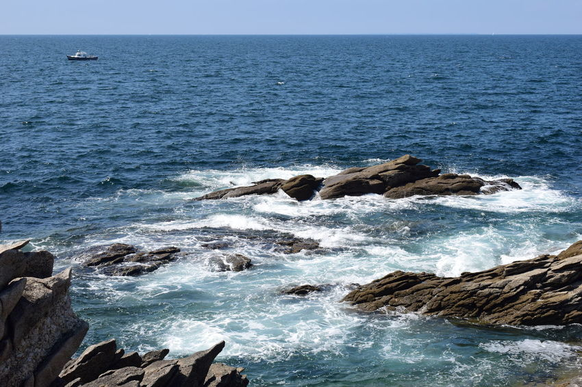 Rocky sea shore, waves, white water Beach Beauty In Nature Breaking Day Hitting Horizon Horizon Over Water Land Motion Nature No People Outdoors Power In Nature Rock Rock - Object Rock Formation Rocky Coastline Scenics - Nature Sea Sky Solid Tranquil Scene Water Wave