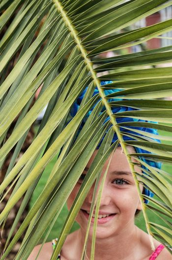 Portrait One Person Headshot Leaf Palm Tree Palm Leaf Plant Part Women Looking At Camera Growth Front View Plant Green Color Adult Beauty Smiling Blond Hair Tropical Climate Beautiful Woman Leaves