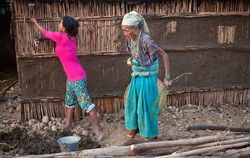 Woman and her mother are working on their house in south Nepal. Only Women Rural Scene Traditional Clothing Girls Women Around The World Nepal Travel Rural Woman Power Family House Building Explore People Culture Life