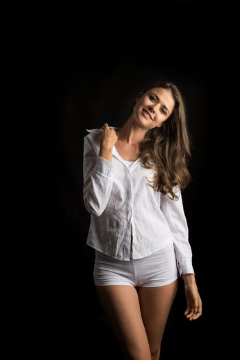 Black Background Studio Shot One Person Indoors  Three Quarter Length Front View Women Young Adult Hair Long Hair Standing Beautiful Woman Hairstyle Beauty Adult Casual Clothing Portrait Looking At Camera Contemplation