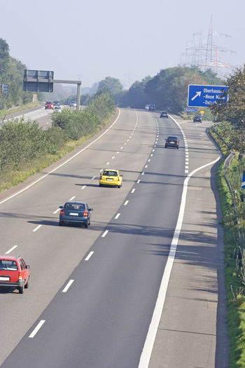 cars on a three-lane autobahn - oberhausen, germany A42 Air Pollution Autobahn Car Driving Freeway Germany High Angle View Highway Highways&Freeways Land Vehicle Mode Of Transport Motion NRW Oberhausen Pollution Road Road Marking Road Sign Ruhrgebiet Speed The Way Forward Traffic Transportation Travel
