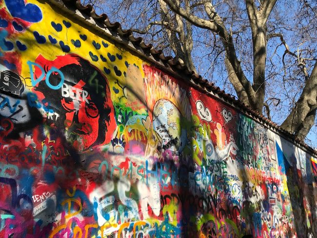Give peace a chance John Lennon Wall Prague AMP PICTURES Low Angle View Day Tree Outdoors No People Close-up