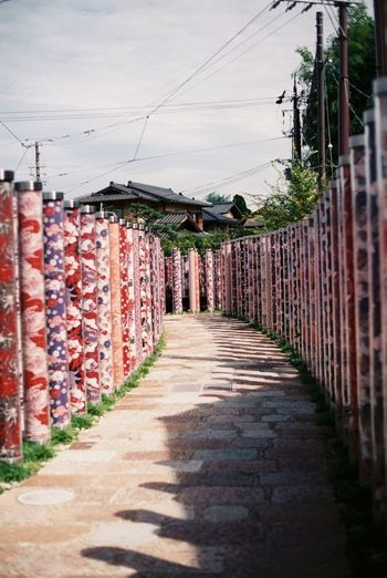 Randen - Arashiyama Station 35mm Film Absence Arashiyama Building Exterior Built Structure Composition Connection Day Film Film Photography Footpath Front Or Back Yard Fuji Superia X-Tra 400 Fujifilm In A Row Japan Narrow Outdoors Pillar Shadow Sidewalk Station Wall Wood Wooden