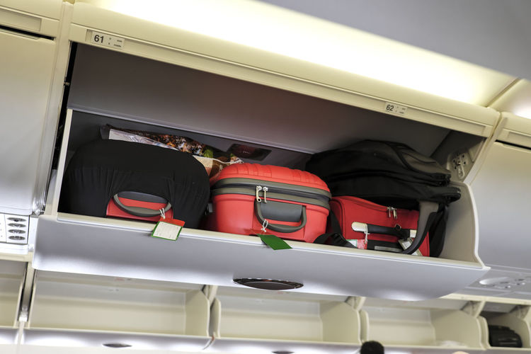 Cabin luggage inside overhead stowage compartment of an airplane Holiday Stowage Travel Airplane Baggage Bags Cabin Compartment Day Indoors  Inflight Luggage Overhead