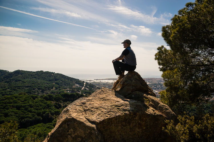 Man standing on rock looking at view