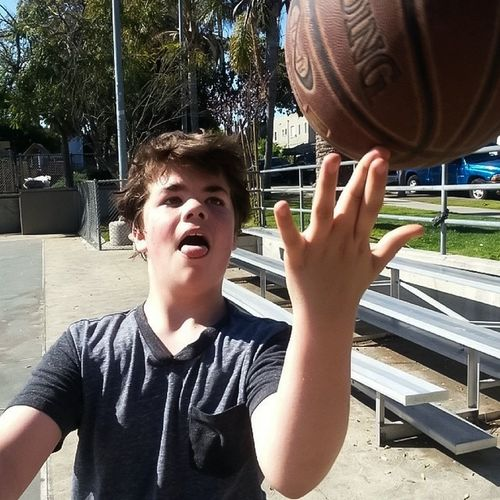 Youth Of Today Basketball Playingbasketball Teenager Boy Portrait Youth Showingoff Being Goofy Athletic Candidshot