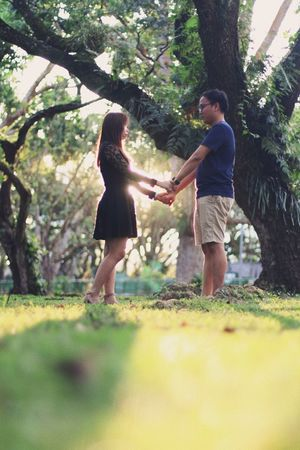 Bonding Boys Casual Clothing Childhood Day Friendship Full Length Happiness Leisure Activity Lifestyles Love Nature Outdoors People Playing Real People Standing Togetherness Tree Two People Young Adult Young Women