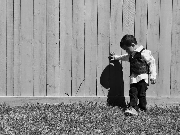 Kid's day. Son Kids Child Blackandwhite Wall Fence Rule Of Thirds Yeg Edmonton Spring Kid Cute Model Pinoy IPhoneography Iphone 6 Iphoneonly The Portraitist - 2016 EyeEm Awards Solo