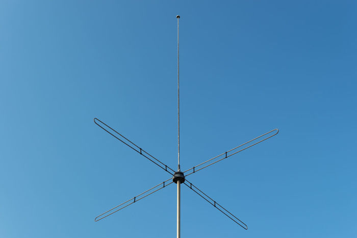 Analog CB Radio City Life Old School Radio Television Antennas Vintage Technology Abstract Antenna Blue Clear Sky Communication Electricity  Low Angle View Metal No People Radio Station Sky Sunlight Symmetry Technology Urban Vintage