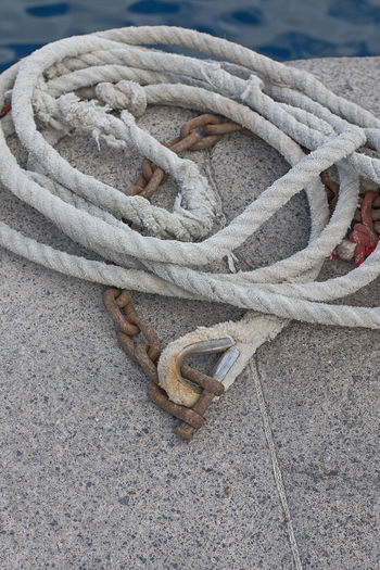 Close-up high angle view of rope on promenade
